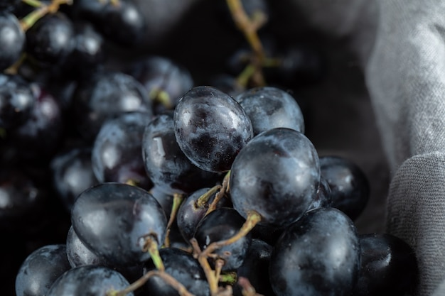 Close up view of black grapes in basket.