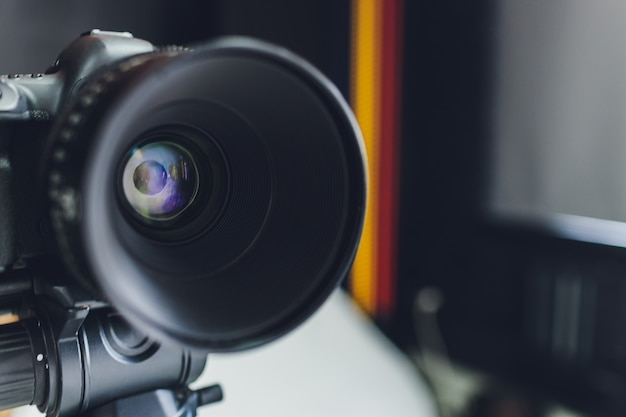 Close-up view on black photo camera lens.