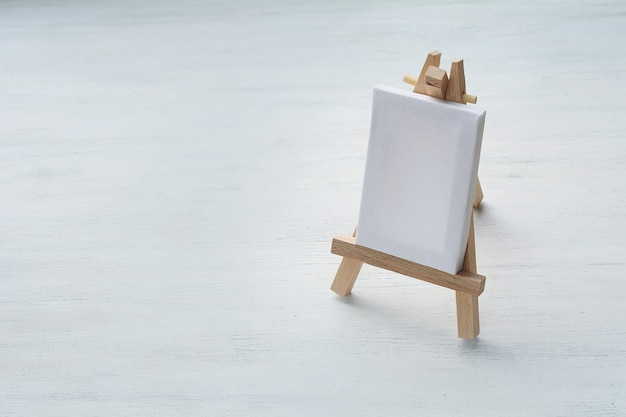 Close up view of blank canvas miniature with easel