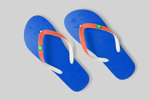 Close up view blue a pair beach sandals isolated on white background. added copy space for text.