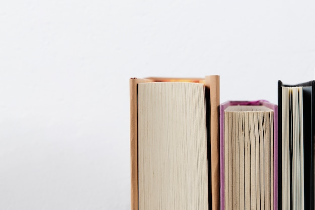 Close-up view of books with plain background