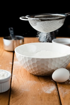 Close-up view of a bowl and sieve
