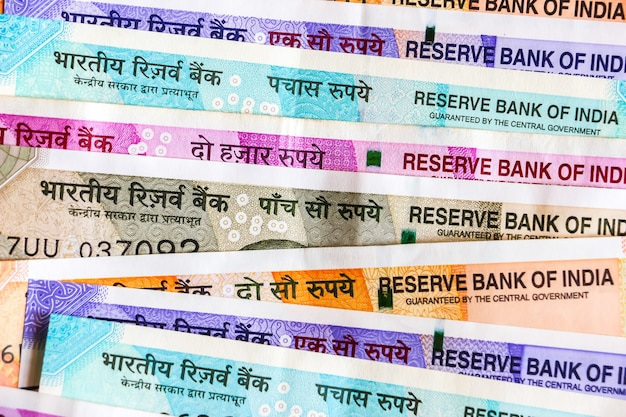 Close up view of brand new indian 50, 100, 200, 500, 2000 rupees banknotes. colorful cash money background.