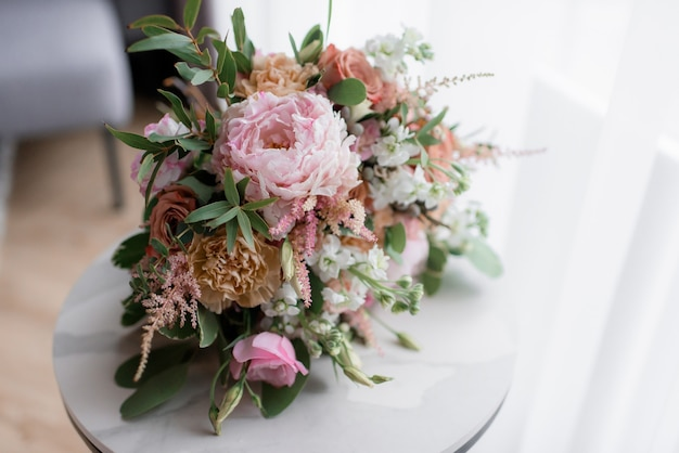 Close up view of bridal bouquet lying on the table