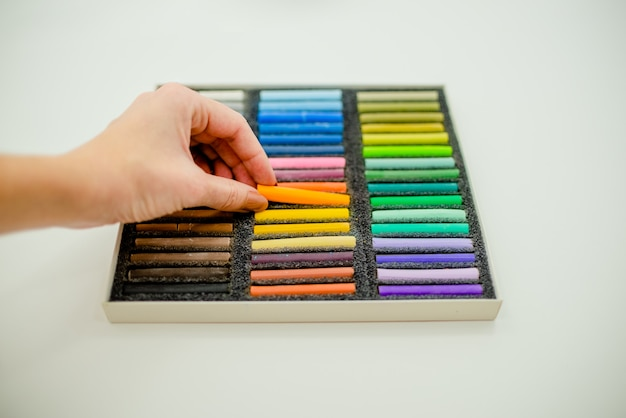 Close up view of bright colorful pastel chalks  on white background.  top view.
