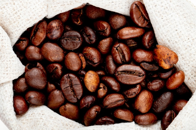 Close up view of brown coffee beans in a sack