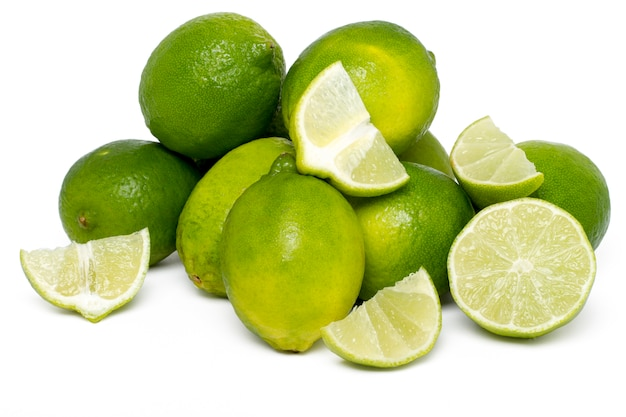 Close up view of a bunch of lime fruits isolated on a white background.