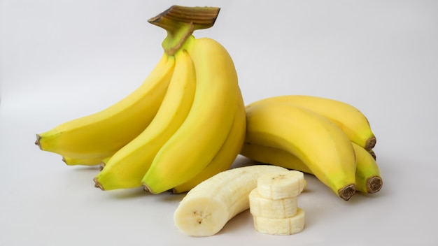 Close up view of bunch and sliced of bananas isolated