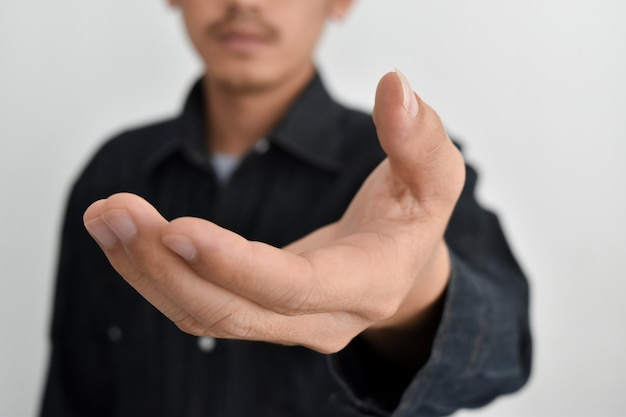 Close-up view of businessman hand reached out to handshake