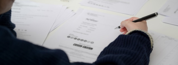 Close up view of businesswoman reading informations on financial document