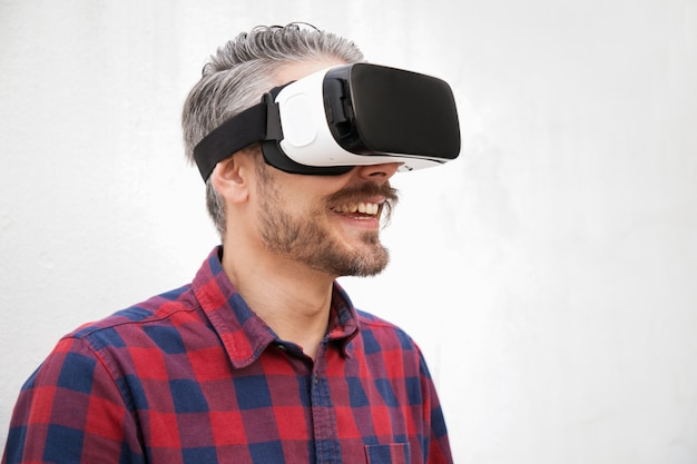 Close-up view of cheerful man in vr headset