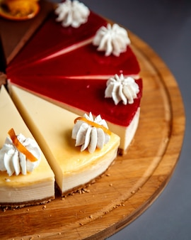Close up view of cheesecake sliced on wooden plate