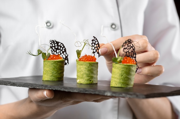 Close-up view of chef holding a food plate