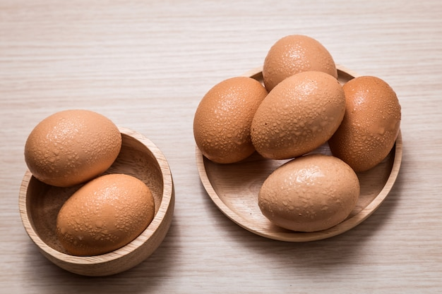 Close-up view of chicken eggs on wooden tabl