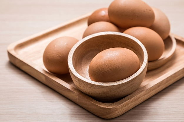 Close-up view of chicken eggs on wooden table