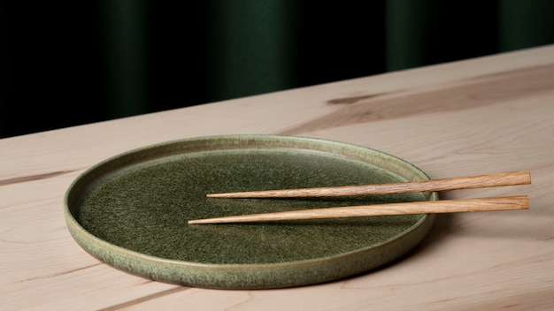 Close-up view of chopsticks on plate
