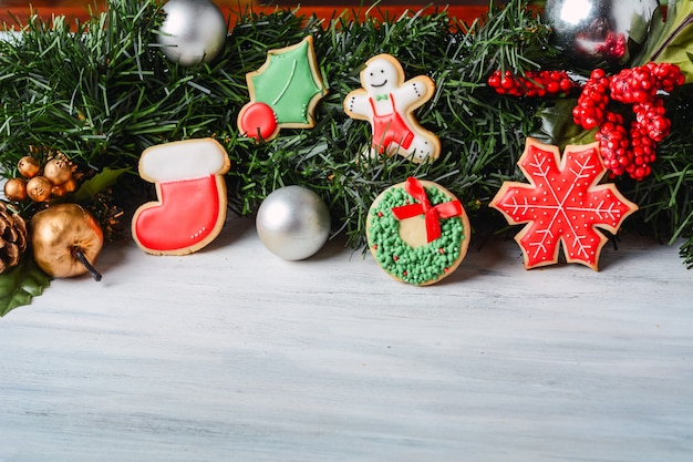 Close up view of christmas cookies with festive branches fir