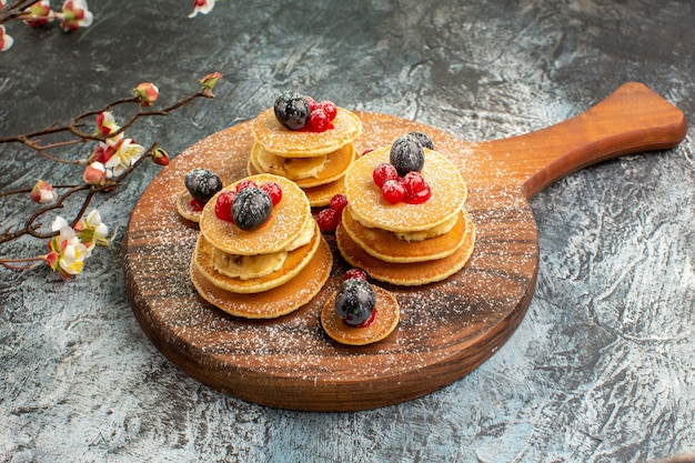Close up view of classic american pancakes with flowers on gray