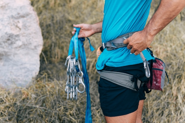 Close up view of climber holding carabiners