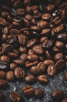 Close up view of coffee seeds on dark
