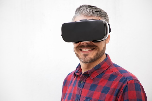 Close-up view of content man in vr headset