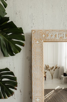 Close up view of the corner of an intricate classic design mirror