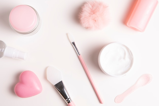 Close-up view of cosmetics on plain background