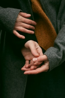 Close-up view of couple holding hands