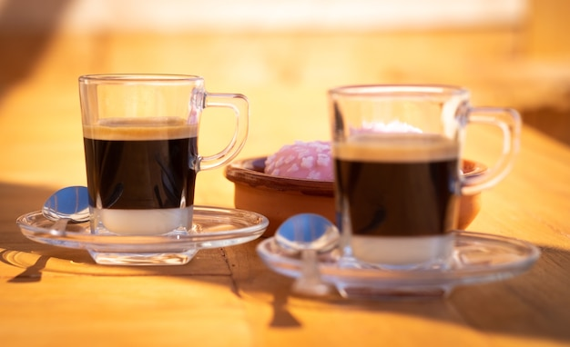 Close-up view of a couple of traditional spanish coffee made with condensed milk and espresso coffee. focus on the most distant cup