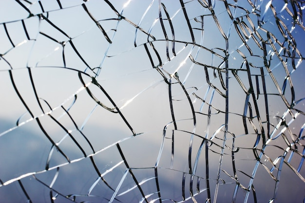 Close up view on a cracked glass background.