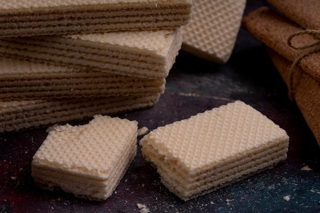 Close up view of crispy waffles on dark