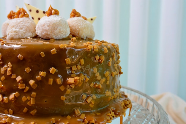 Close up view of delicious dulce de leche cake with chocolate truffle on topping, sweet dessert