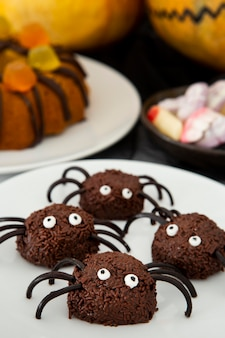 Close-up view of delicious halloween spider candies