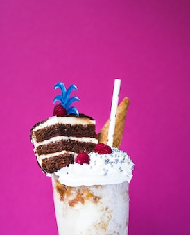 Close-up view of delicious milkshake with plain background