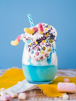 Close-up view of delicious milkshake on wooden table