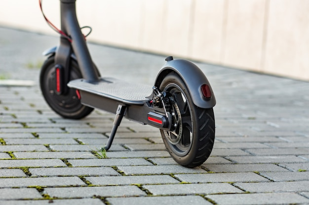 Close up view of e-scooter parked on sidewalk