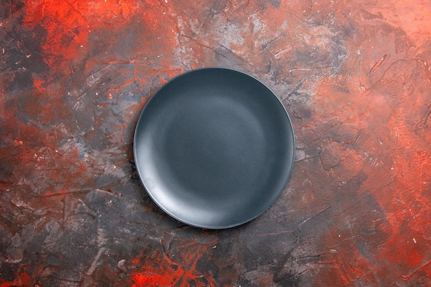 Close up view of empty black plate on black
