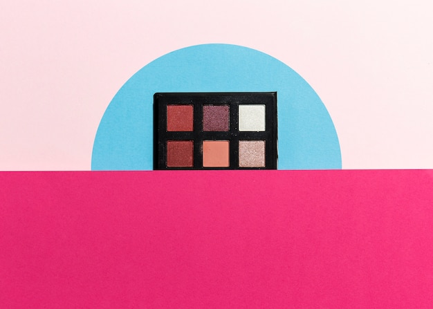 Close-up view of eye shadow on plain background