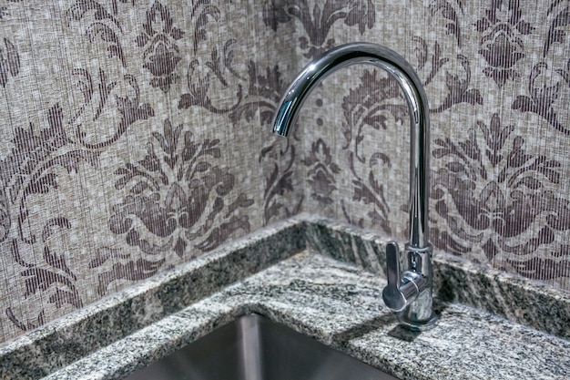 Close up view of faucet tap on the sink