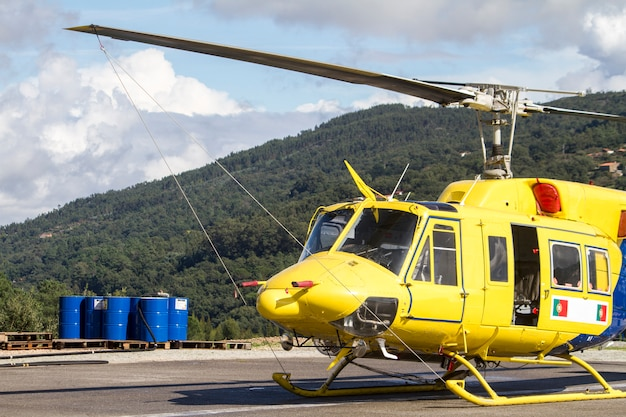 Close up view of a fire fighter helicopter parked.
