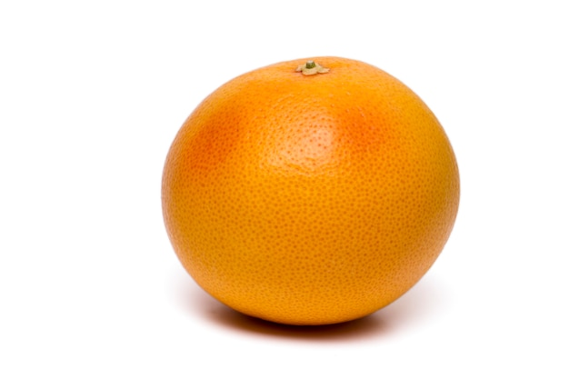Close up view of a fresh and healthy grapefruit isolated on a white background.