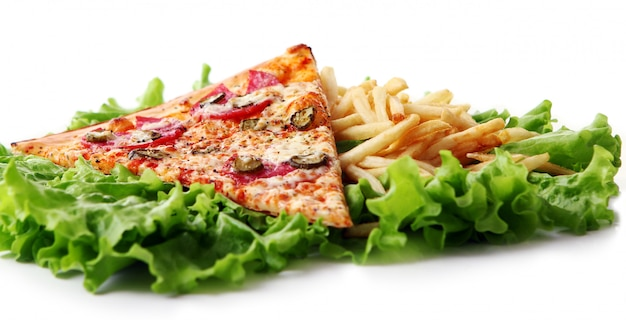 Close up view of fresh pizza with french fries