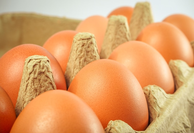 Close up view fresh raw chicken eggs in brown box carton purchased from the market,mart,su