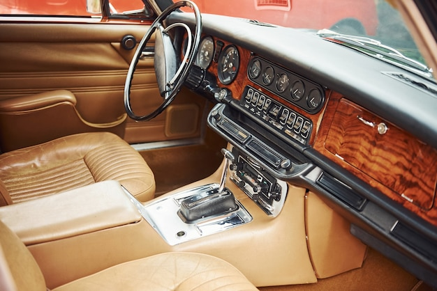 Close up view of front part of luxury old retro automobile.