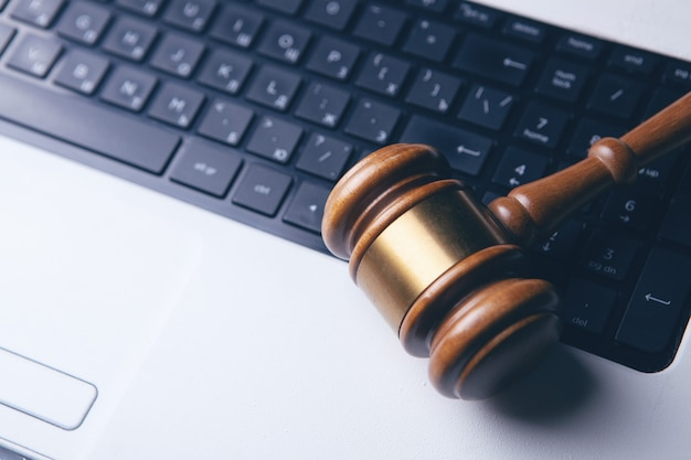 Close up view of a gavel and a computer keyboard