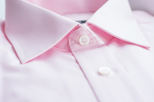 Close up view of a generic pink business shirt.