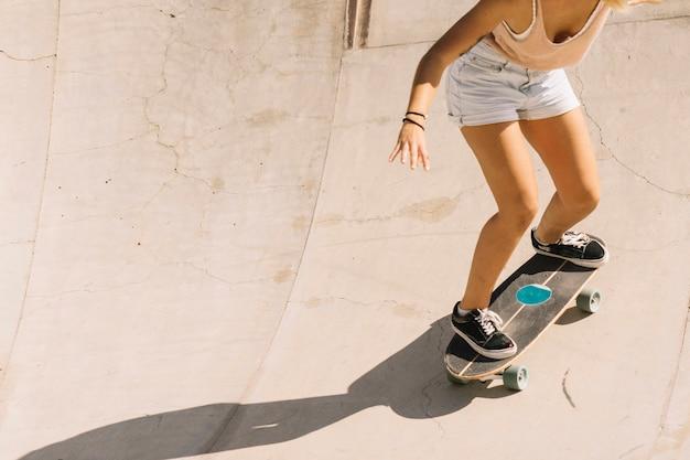 Close up view girl skating