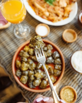 Close up view of grape leaves dolma on a fork
