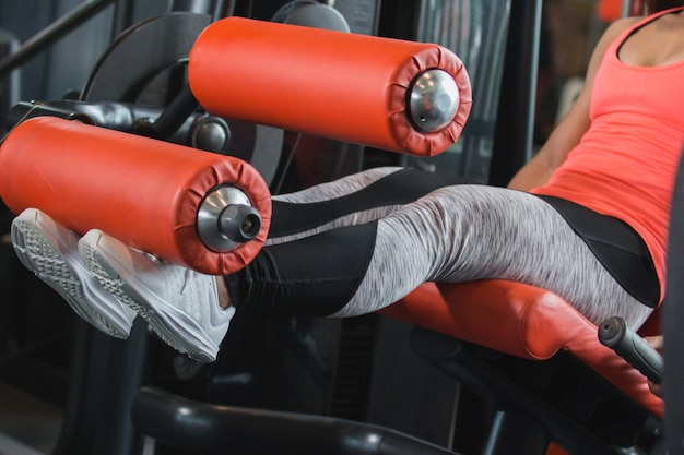 Close up view gym seated leg curl