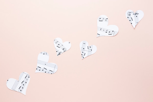 Close-up view of hearts with musical notes on plain background